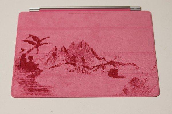 Artwork engraved onto inside of pink cover