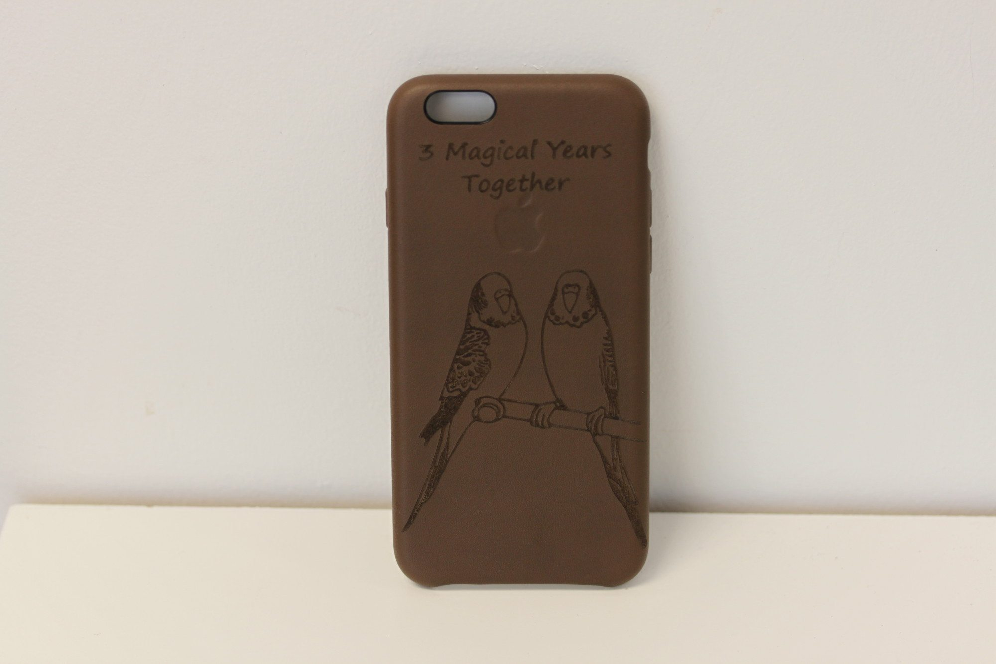 laser engraved leather iphone case olive brown in a