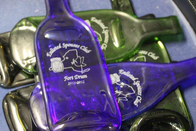 Laser etched flattened wine bottles
