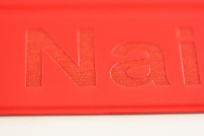 Details: Engraving of Red Polyurethane Smart Cover